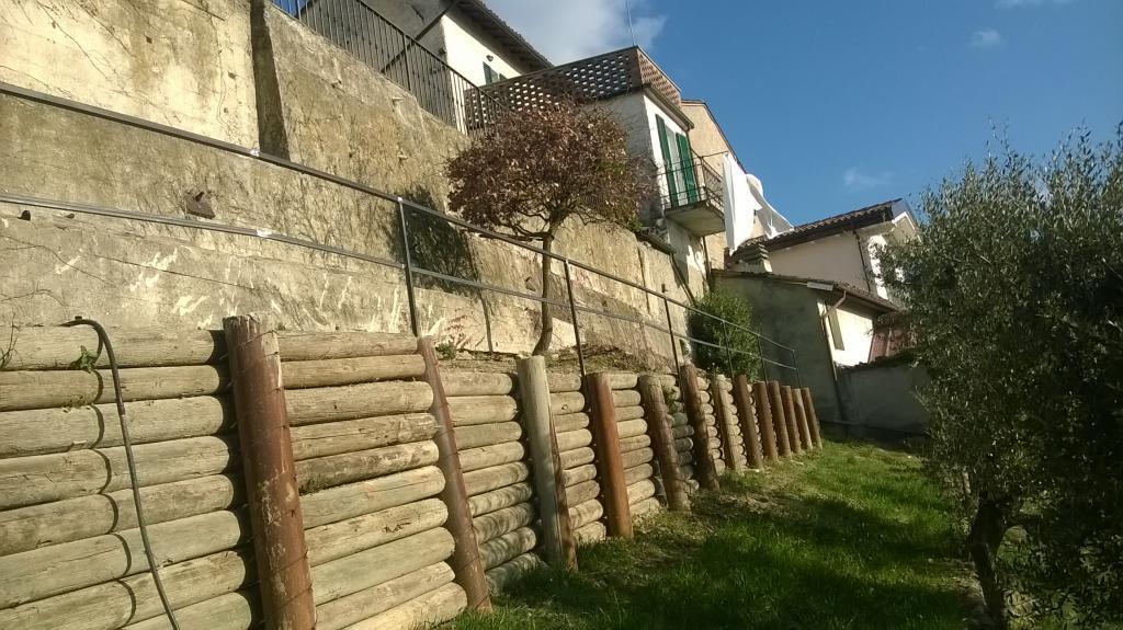 Palizzate in legno e acciaio impresa cauda - Palizzate in legno per giardino ...